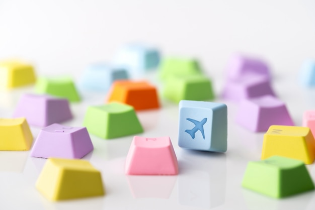 Colorful travel icon on computer keyboard for online booking concept