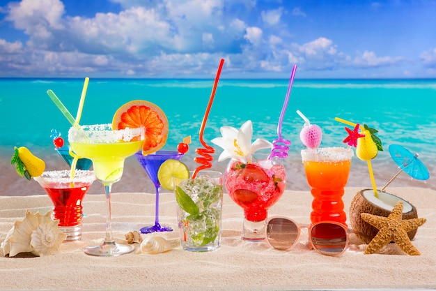Colorful tropical cocktails at beach on white sand