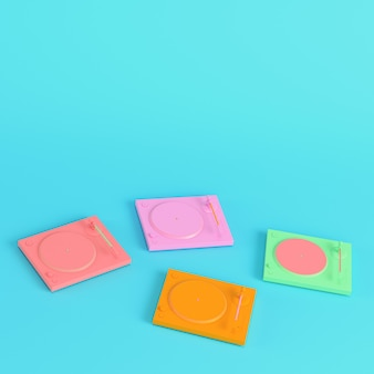Colorful turntables on bright blue background in pastel colors. minimalism concept. 3d render
