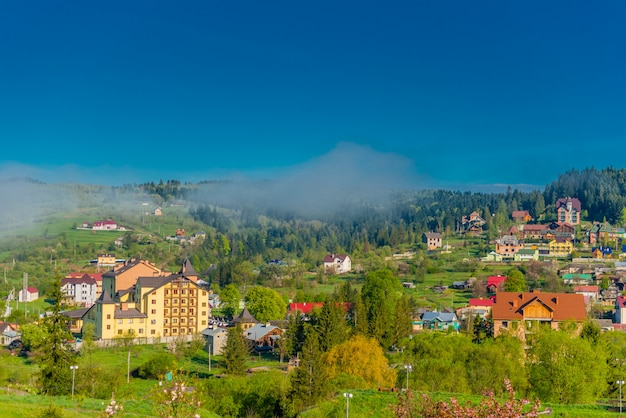 Colorful  ukrainian village on the mountain hills in the morning