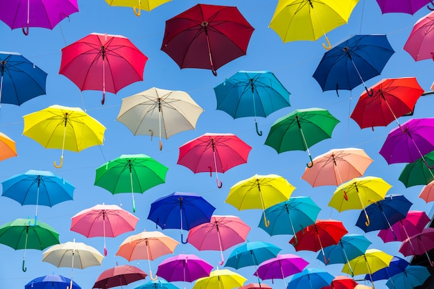 Colorful umbrellas background. colorful umbrellas in the sky.