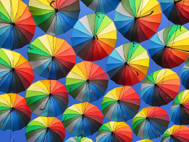 Colorful umbrellas in the sky.