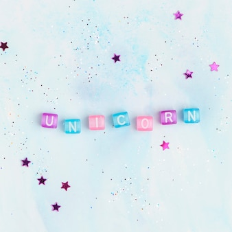Colorful unicorn beads text typography