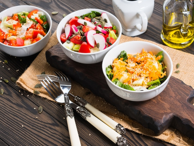 Colorful vegetable salad bowl for lunch on wooden rustic
