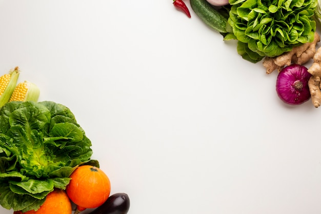 Colorful veggies on white background with copy space
