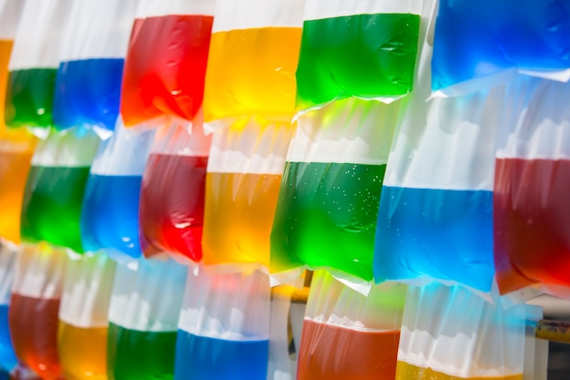 Colorful water in a hanging plastic bag.