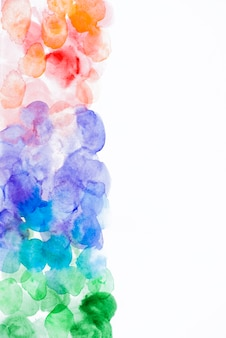 Colorful watercolor bolt texture on white paper