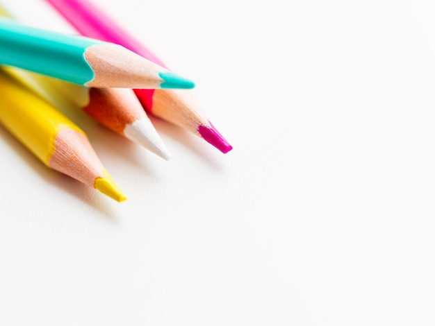 Colorful watercolor pencils on white background. school supplies
