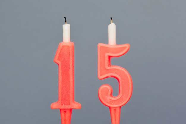 Colorful wax birthday candle  on grey background