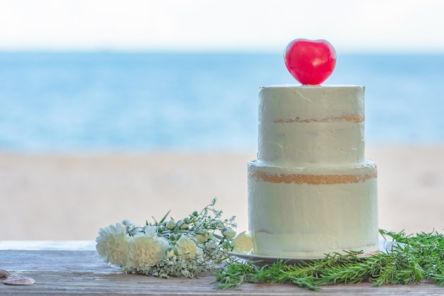 Colorful wedding cake at the beach