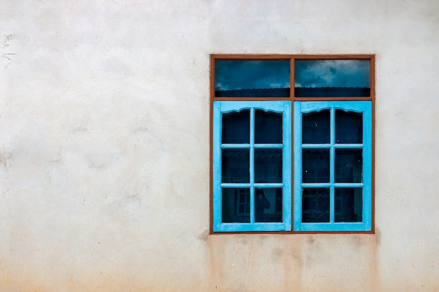 Colorful window on a concrete wall