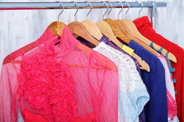 Colorful womens clothes on hangers on rack in fashion store. wom
