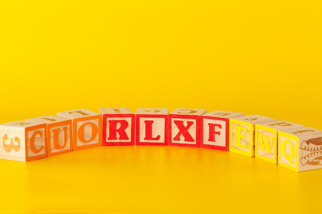 Colorful wooden blocks with letters