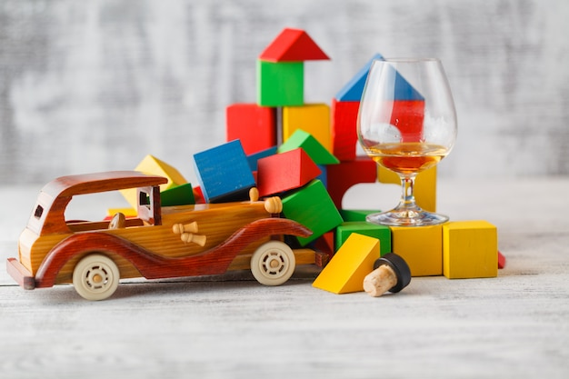 Colorful wooden blocks with toy cars arranged with imagination to be car crash scene.