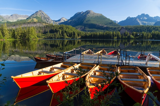 Colorful wooden boat on the mountain lake.