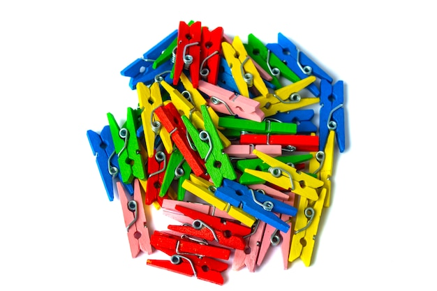 Colorful wooden clothespins on white