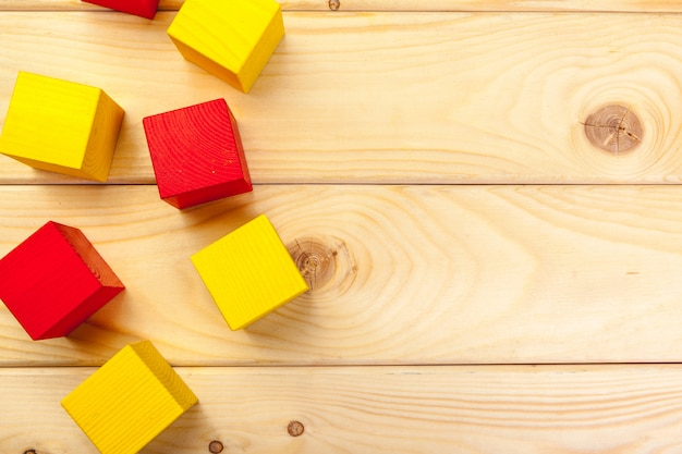 Colorful wooden cubes on wooden table