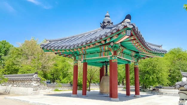 Colorful wooden gazebo painted in traditional korean floral style