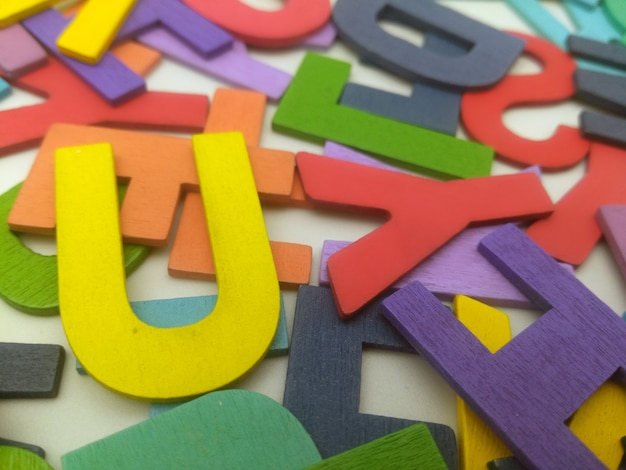 Colorful wooden letters on a white background - pictures