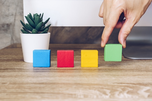 Colorful wooden toy blocks on the table