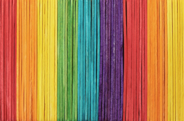 Colorful wooden wall texture background in bright rainbow colors