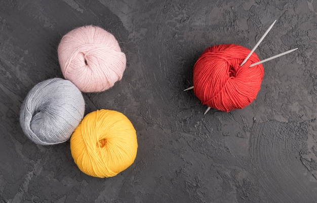 Colorful wool yarn on slate background