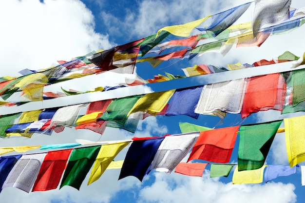 Colorful worship flag with blue sky background in nepal