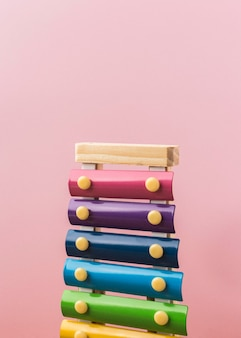 Colorful xylophone arrangement on pink