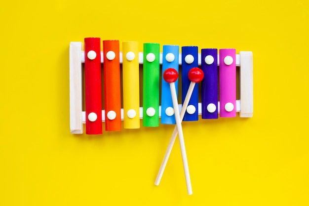 Colorful xylophone on yellow isolated.
