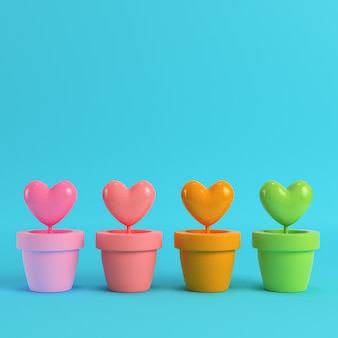Colorfull hearts in the pots on red box on bright blue background
