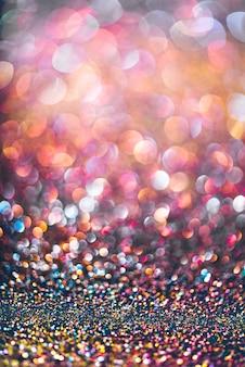 キラキラゴールドボケcolorfullぼやけた周年記念の抽象的な背景