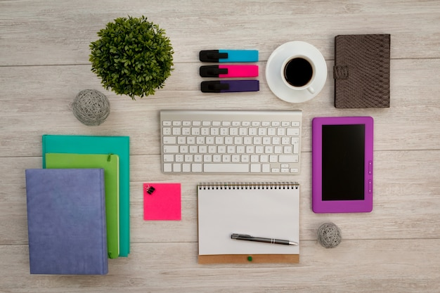 Colorfully business desktop objects on a grey table