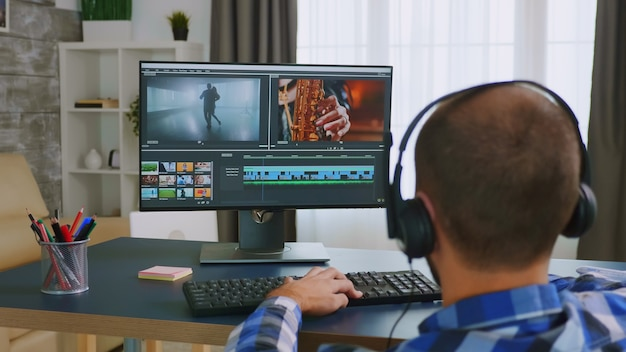 Colorist in wheelchair using editing software.