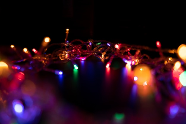 The colors of the lights are flashing blue, green, purple and orange in the form of bokeh.
