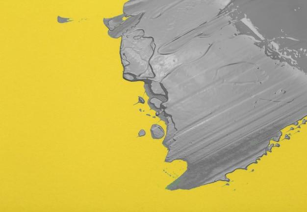 2021 년 얼티밋 그레이 및 일루미 네이 팅 옐로우 컬러. 노란색 배경 조명에 궁극적 인 회색 페인트.