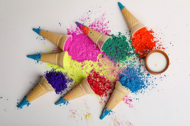 Colors in shapes of ice cream scoops in cones for indian holi festival