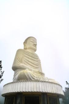 Colossal sitting buddha statue at ba na hills near da nang, vietnam