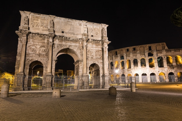 Colosseum and arch of triumph in rome at night