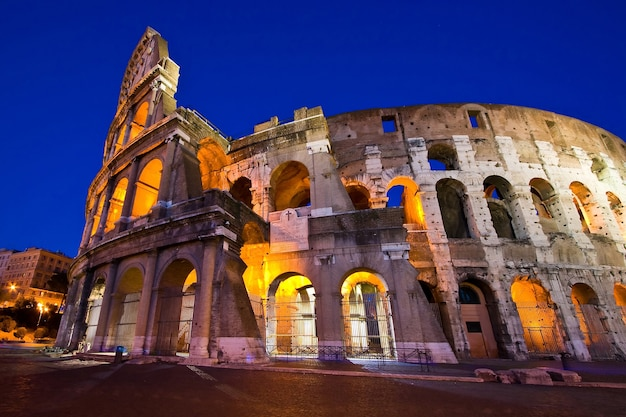 Colosseum in twilight with ultra-wild perspective at dusk, rome italy