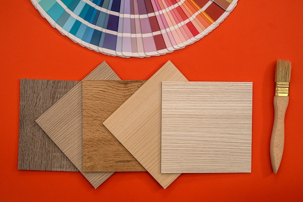 Colour swatches book with wooden sampler, paint brush, renovation concept