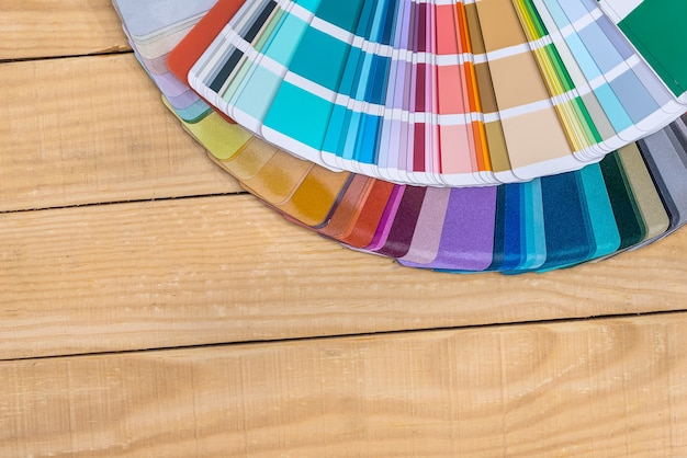 Colour swatches in fan on wooden background