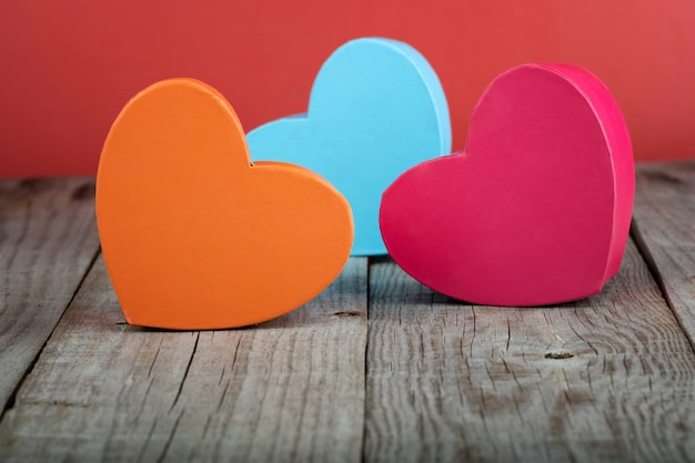 Coloured heart shaped gift boxes on a wooden base. valentine's day concept
