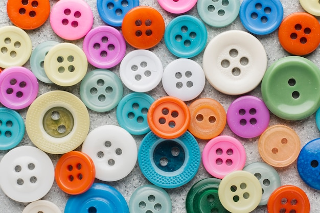 Coloured sewing buttons composition background