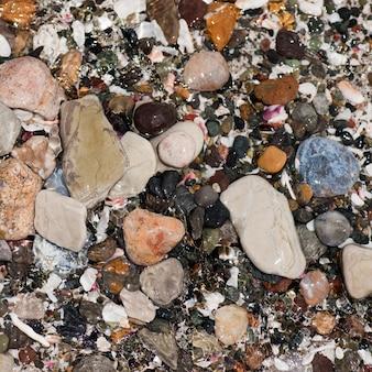 Coloured stones and pebbles along the shoreline in costa rica