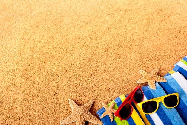 Coloured sunglasses over a beach towel