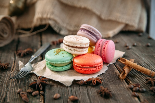 Coloured sweet macaron dessert on the wooden table