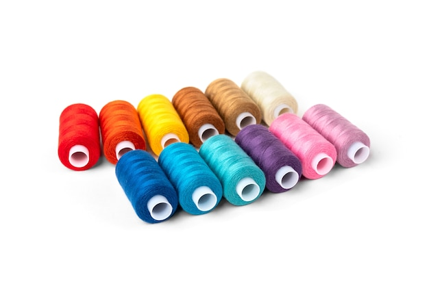Coloured threads isolated on white background.