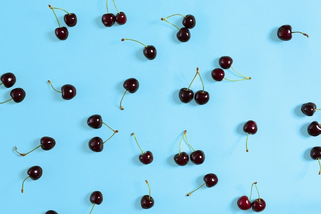 Colourful bright pattern with ripe cherry. top view. copy space. flat lay