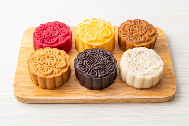 Colourful chinese moon cakes with mixed flavour on wood plate