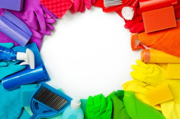 Colourful cleaning products and tools isolated on white. flat lay.